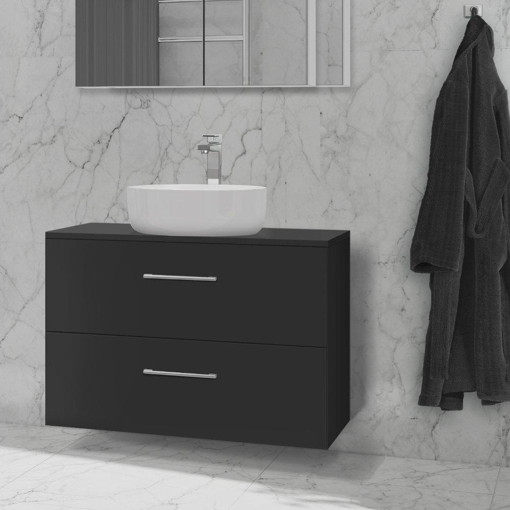 Helle topplate i fargen mørk grå for toppmonterte vasker.